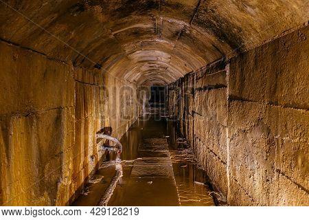 Old Dark Vaulted Underground Flooded Sewer Tunnel