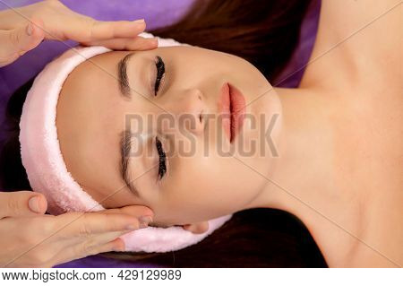 Face Massage. Close-up Of Young Woman Getting Spa Massage Treatment At Beauty Spa Salon.spa Skin And