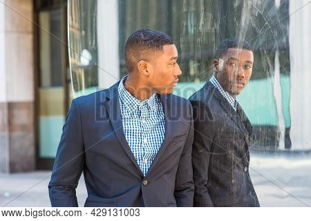 Young African American Businessman Wearing Blue Jacket, Patterned Shirt, Standing By Mirror, Turning