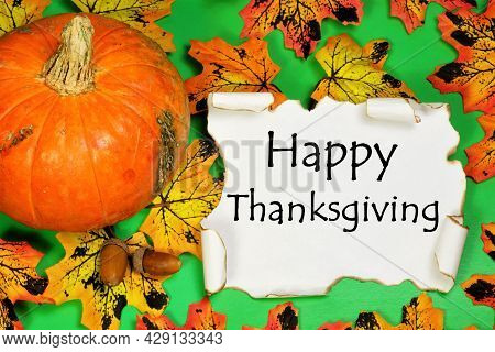 Happy Thanksgiving. The Inscription On A Vintage Scroll On The Background Of Pumpkins, Acorns And Au