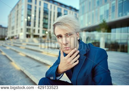 White Collar Worker In Business Suit Sits Near Office Building.