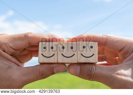 Smile Face And Cart Icon On Wood Cube. Optimistic Person Or People Feeling Inside And Service Rating