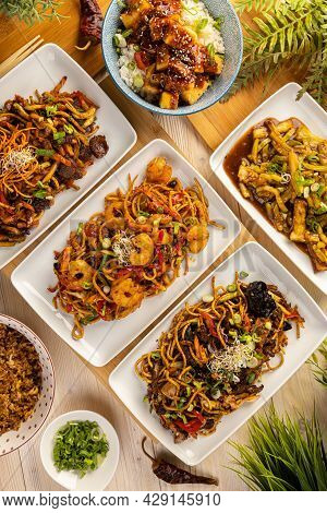 Top View Composition Of Various Asian Food Served On White Plate