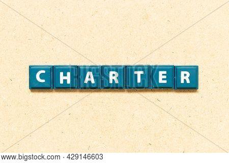 Tile Alphabet Letter In Word Charter On Wood Background