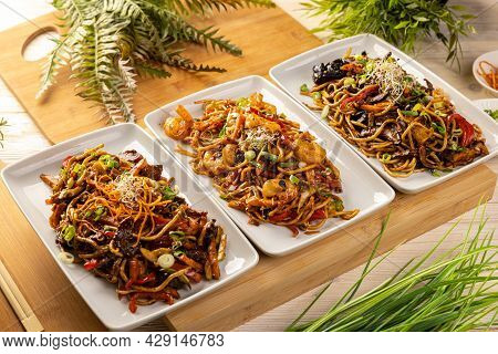Asian Food Dishes. Three Plate With Stir Fry Noodles.