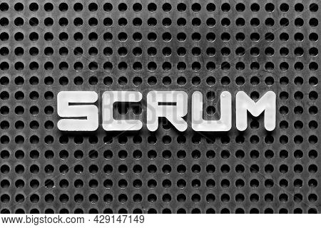 White Alphabet Letter In Word Scrum On Black Pegboard Background