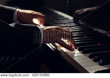 Man Playing Grand Piano, Closeup. Talented Musician