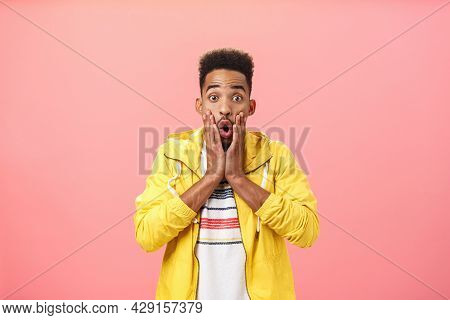 Delighted Surprised Nice African American Guy In Stylish Outfit With Beard And Curly Haircut Folding