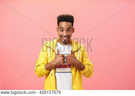 Energetic Pleased And Delighted African American Male With Beard And Afro Hairstyle In Stylish Yello