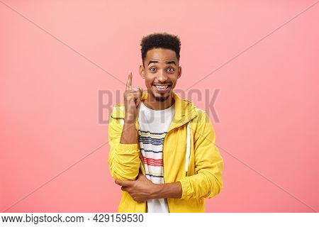Enthusiastic Pleased African American Guy Adding Suggestion Raising Index Finger In Eureka Gesture A