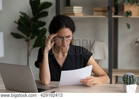 Close Up Dissatisfied Businesswoman In Glasses Reading Bad News