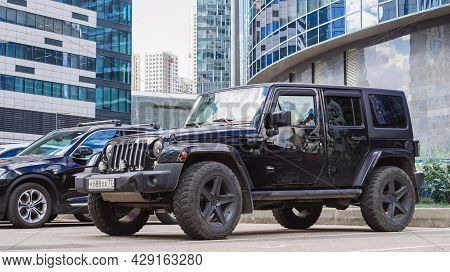 Black Jeep Wrangler Unlimited 4x4 Suv Car Parked On The Street In The City. Moscow, Russia - August