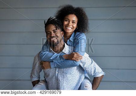 Portrait Of Happy Ethnic Couple Hugging Embracing