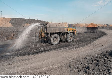 Watering Machine Cutaway. Large Quarry Dump Truck. Big Yellow Mining Truck At Work Site. Production