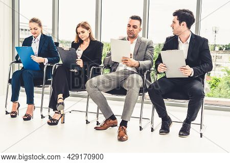 Businesswomen And Businessmen Holding Resume Cv Folder While Waiting On Chairs In Office For Job Int