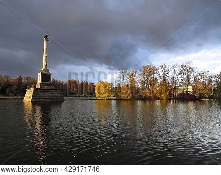 Chesme Column On Large Pond In Catherine Park In Pushkin, Saint Petersburg, Russia. Column Built In