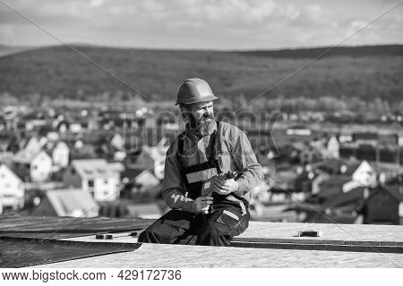 Roofer Constructing Roof. Man Roofing Surface. Install Partially Overlapping Layers Of Material Over