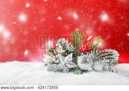 Christmas Decoration With Fir Branch And Balls On Snow