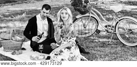 Romantic Picnic Date With Wine. Couple In Love Celebrate Anniversary Picnic Date. Melt Her Heart. Cr