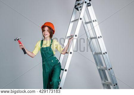 Child Architect Worker. Engineer Use Hammer. Laborer Kid Wear Safety Hardhat. Labor Day