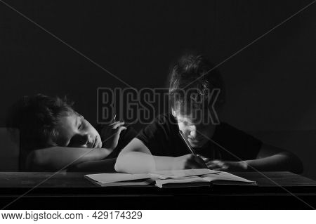 Diligent Pupil. Tired Schoolboy Does His Homework, Black And White Photo, Long Exposure, Multi-expos