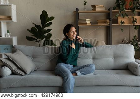 Smiling Woman Talking On Phone, Enjoying Conversation, Sitting On Couch