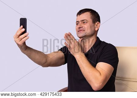 Deaf Adult Man Using Hearing Aid To Communicate Freely With Relatives On A Video Call And Feel Himse