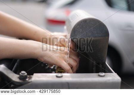 Female Wash Rug In Water. Close-up Womans Hand In Front Of Car On Sel Servise Car Wash