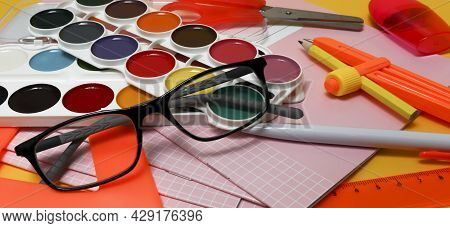 Glasses And School Supplies. The Concept Of Vision Loss In Children During School, Problems With Rat