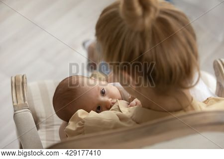 Close Up Of Young Mom Breastfeed Small Baby Infant