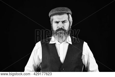 Retro Man In Peaked Cap. Portrait Of Mature Man In Victorian Gangster Outfit. Bearded Man Hipster Is