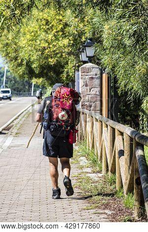 San Vicente De La Barquera, Spain - Sep 08, 2020: Pilgrim Walking Towards San Vicente De La Barquera