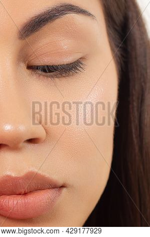 Close Up Beauty Of A Half Face Of A Woman With Wet Radiant Skin And Big Gray Eyes. Fashionable Natur