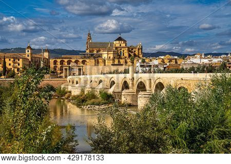 Cordoba, Spain - October 31, 2019: Mezquita-catedral And Puente Romano - Mosque-cathedral And The Ro