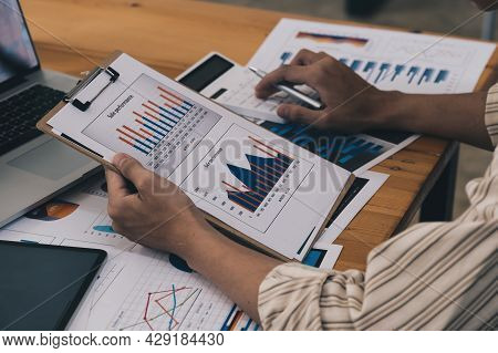 Close-up Of A Businessman Using A Calculator To Audit The Companys Budget. Tax Information Is Calcul