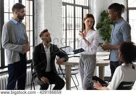 Young Diverse Businesspeople Engaged In Team Thinking In Office