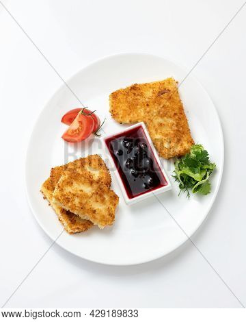 Platter With Crispy Nuggets Or Pieces Of Fried Cheese In Breadcrumbs, Deeping Red Berry Sauce, Tomat