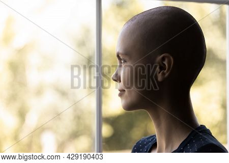 Optimistic Cancer Woman Looking Out Window With Hope