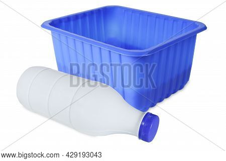 Blue Plastic Box And Plastic Bottle Isolated In White. Blue Plastic Container And Bottle For Milk