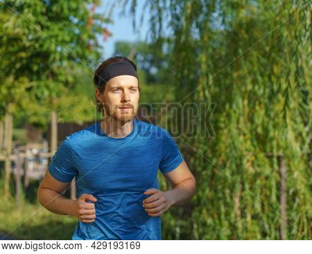 Staying Fit And Healthy. Full Length Of Athletic European Man In Sportswear Enjoying Morning Run Out