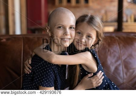 Portrait Of Happy Optimistic Cancer Patient Mom Embracing Daughter