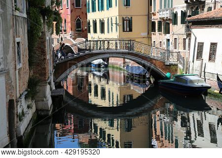 One Of The Characteristic Canals Of Venice. High Quality Photo