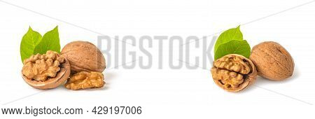 Walnut Fruits Lie On A White Isolated Background. Peeled Walnut And Green Leaves With Shadow. White