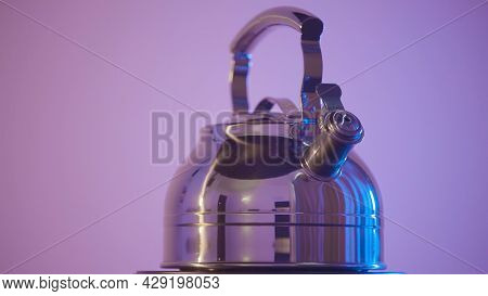 Metal Teapot On Isolated Background. Action. Beautiful Shiny Kettle For Boiling Water. Metal Kettle
