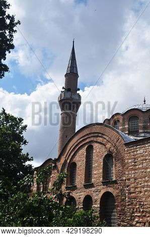 Brick Wall Of The Old Mosque And Minaret. Cloudy Day In Istanbul.