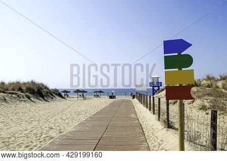 Wooden Walkway To The Beach Of Casita Azul In Isla Cristina, Huelva, Andalusia, Spain