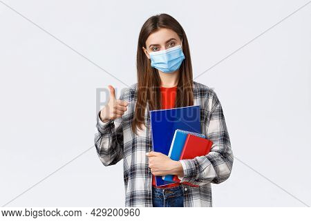 Coronavirus Pandemic, Covid-19 Education, And Back To School Concept. Pleased Young Female Freshman
