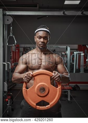 Handsome Muscular Athletic African American Man Exercising With Weight Plate In Hands. Strength Trai