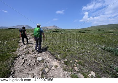 Hikers On Trail In Alpine Tundra Above St Marys Glacier And Above Treeline In Arapaho National Fores