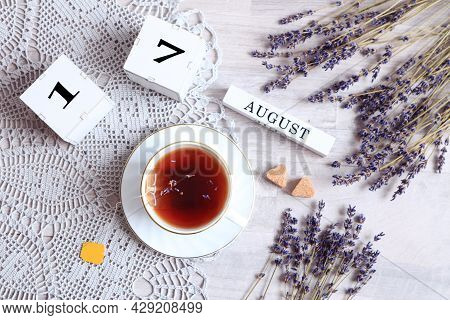 Calendar For August 17 :the Name Of The Month Of August In English, Cubes With The Number 17, A Cup